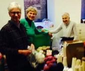 Susan Abrams, Susan Butler and Julia Bryant sort yarn at the new work station.